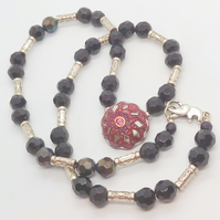 Long Necklace with Black Faceted Beads Silver Spacers and a Red Button Centre