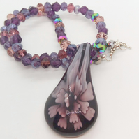 Purple Teardrop Glass Pendant with A Flower Pattern on a Crystal Beaded Necklace