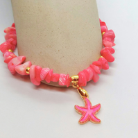 Pressed Coral Beaded Bracelet With A Gold Plated Pink Enamelled Starfish Charm