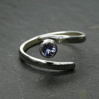 Sterling silver proud isolde ring. twist, adjustable, resizeable. Tanzanite