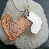Hammered sterling silver and copper, twin, heart necklace. The Amity pendant.