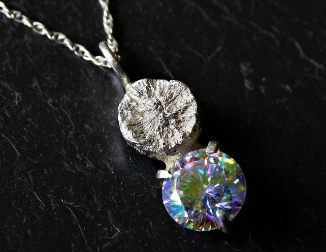 Cast shell and rainbow cubic zirconia pendant