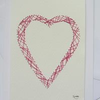 Pink embodered heart outline