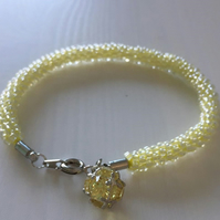 Yellow Beaded Kumihimo Bracelet with Rhinestone Charm