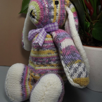 Annabelle Rainbow Rabbit in strippy yarn, hand knitted soft toy.