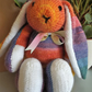 Rainbow Rabbit in Ice strippy yarn, hand knitted soft toy.