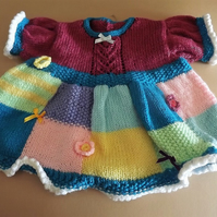 Patchwork hand knitted Dress in a rainbow of colours. 6-12 months