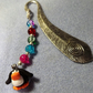 Engraved Silver Plated Feather Bookmark with Rainbow Beads and Penguin Charm.