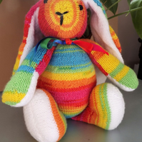 Bright Rainbow Rabbit, hand knitted soft toy.