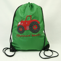 Red tractor with 'Ffermwr bach' slogan on green gym bag
