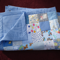 Handmade Quilt For Baby In Cotton And Polycotton With A Blue Backing