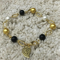 Gold Plated Bracelet with Black and gold crystal beads and White Pearls