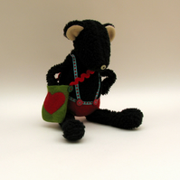Black Bear dressed in red shorts - Handmade plush sculpture.