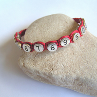 Child's Red Woven Bracelet with Telephone Contact Number