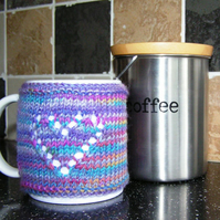 Hand Knitted Multicoloured Mug Cosy with Heart Design
