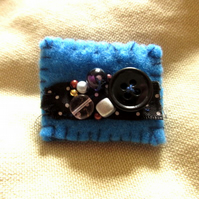 Blue and black eclectic felt brooch