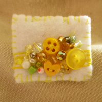 Pretty handmade brooch in white and yellow