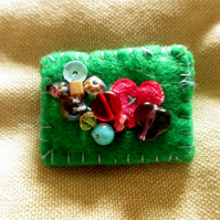 Eclectic primary brooch