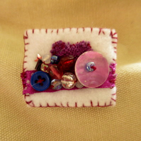 Pretty handmade brooch in purple and white