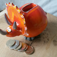 Triceratops pottery money box