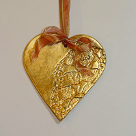 Handmade gold hanging heart decoration