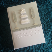 Braille wedding card- champagne glasses & cake.