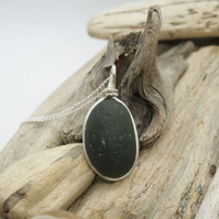 Dark green seaglass pendant wrapped in stirling silver