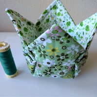 A set of two fabric pots containers in green prints.