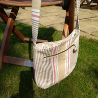 Casual light weight crossover body bag in stripes.