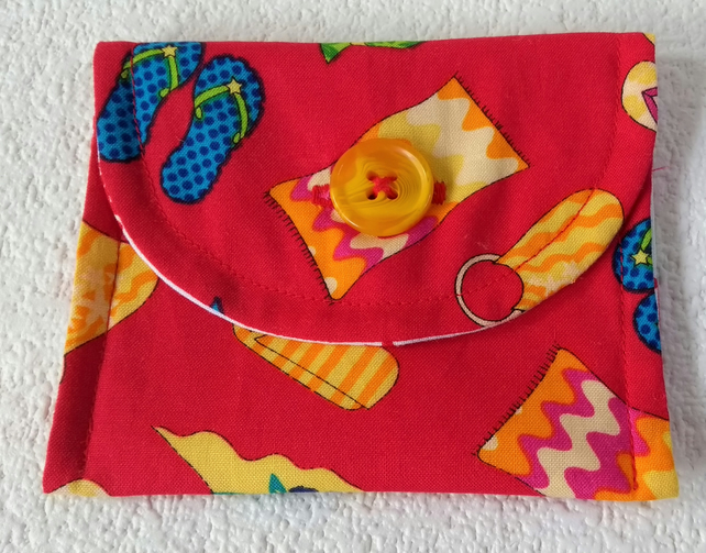 Button fastening coin or card purse in a beach holiday theme print