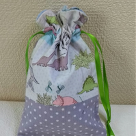 Gift  Bag in a cute dinosaur print with a drawstring closure