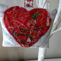 Hanging lavender bag with applique red heart.