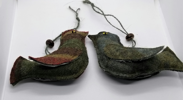 A pair of hanging decorative love birds in brown and green tweed fabric.