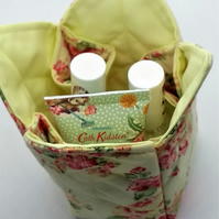 Quilted fabric pot in a floral print on yellow.