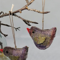 A pair of little mauve and green tweed birds