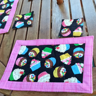 Set of two Cup Cake quilted place mats and coasters.