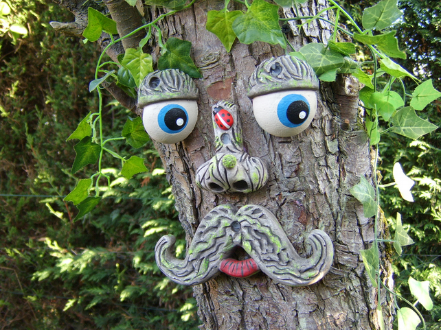 Large Moustached Tree Face, garden ornament, tree decoration sculpture statue.
