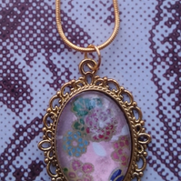Delicate Oval Pendant with Japanese Design