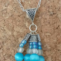 Beautiful Beaded Blue and Silver Glass Pendant