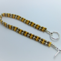 Silver, bronze and gold seed bead bracelet