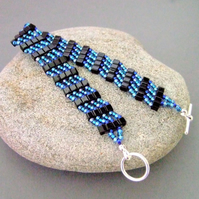 Black cube and blue seed bead bracelet