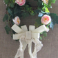 Faux ivy and peony double wreath,pearl bead cobweb detail and cream lace bow