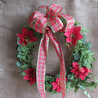 Large vine wreath with faux fir,ivy and red  poinsettia  ,finished with a bow