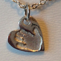 silver hand or foot print charm
