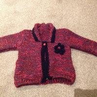 Sparkly Red and black jacket with flower detail