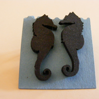 Seahorse silhouette earrings