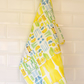 Yellow fantastic plastic tea towel