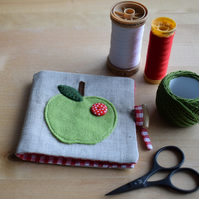 Linen Needle Book - appliqued green felt apple with red spotty button.