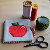 Linen Needle Book - appliqued red felt apple with red spotty button.