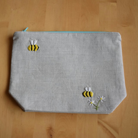 Linen project bag with embroidered bees and daisies.